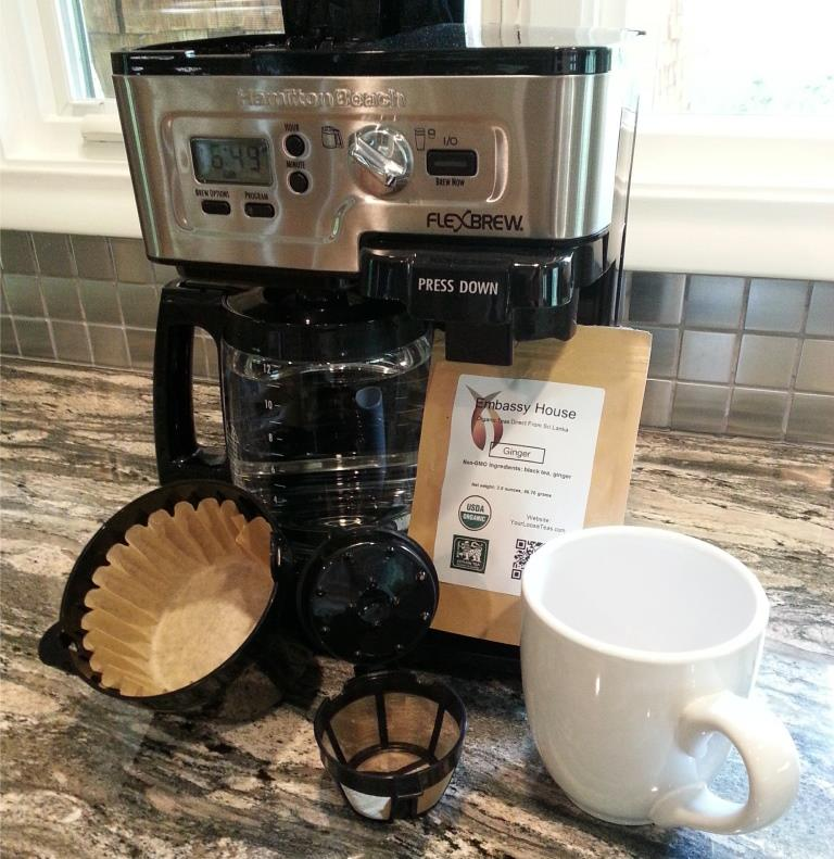 How to brew loose tea using a drip coffee maker.  Items displayed drip coffee maker, tea, mug, individual and pot filters.