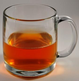 Black Tea vs Green Tea - Infused Black Tea In A Glass Mug