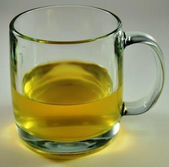 Black Tea vs Green Tea - Infused Green Tea In A Glass Mug